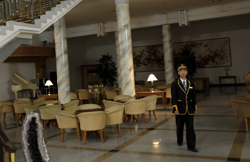In this Oct. 23, 2018, photo, a staff member walks past an empty cafe at the Kumgangsan Hotel in the Mount Kumgang resort area in North Korea. At the