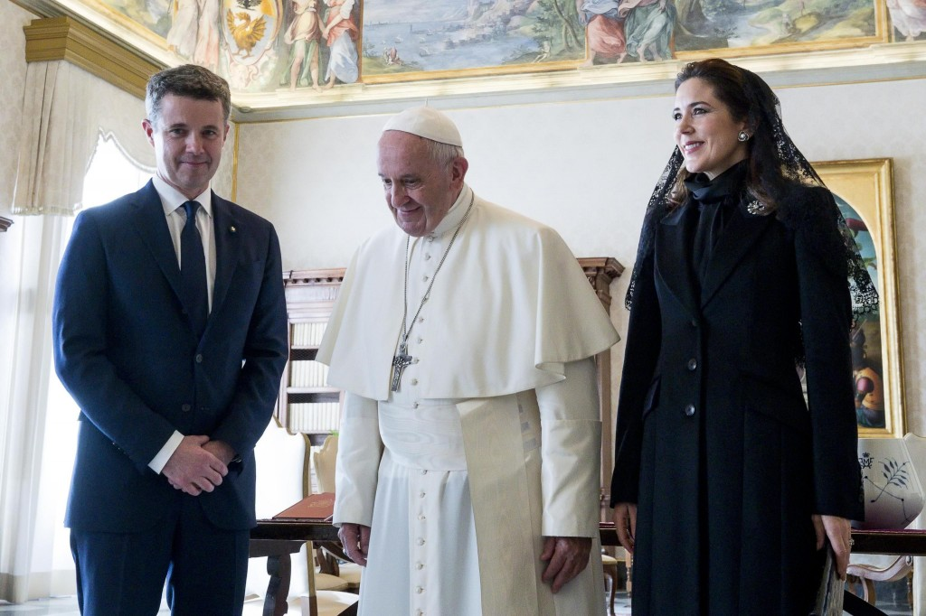 Pope Francis walks with Danish Crown Prince Frederik, left, and his wife Crown Princess Mary, on the occasion of their private audience, at the Vatica...