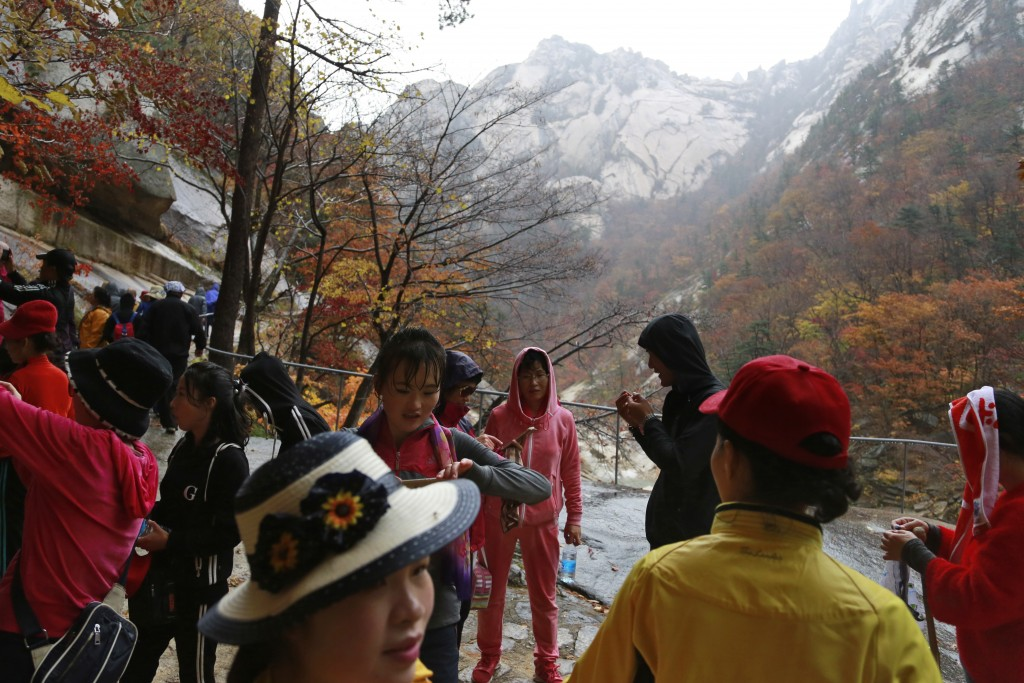 In this Oct. 23, 2018, photo, tourists visit Mount Kumgang in North Korea. A decade after the North-South experiment in tourism cooperation in Kumgang