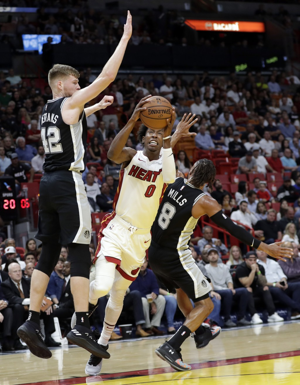 Miami Heat guard Josh Richardson (0) drives as San Antonio Spurs forward Davis Bertans (42) and guard Patty Mills (8) defend during the first half of ...