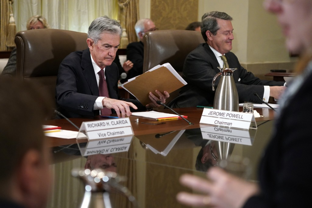 FILE- In this Oct. 31, 2018, file photo Federal Reserve Chair Jerome Powell, left, and Randal Quarles, vice chair for supervision, gather their things...