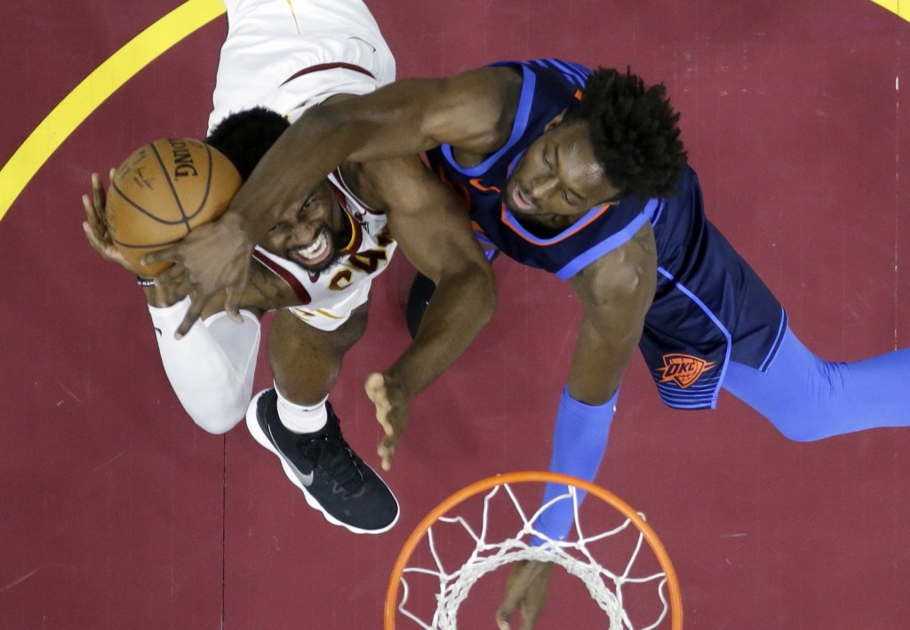 Oklahoma City Thunder's Jerami Grant, right, blocks a shot by Cleveland Cavaliers' David Nwaba during the first half of an NBA basketball game Wednesd...