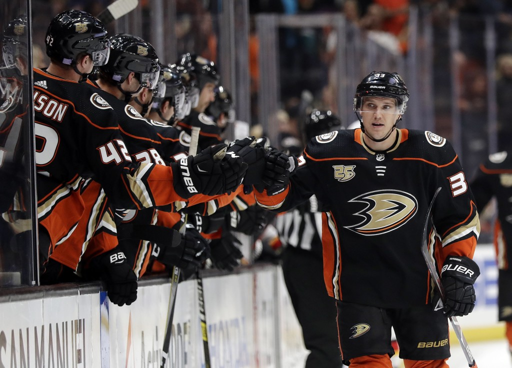 Anaheim Ducks' Jakob Silfverberg, right, celebrates his goal with teammates during the first period of an NHL hockey game against the Calgary Flames o