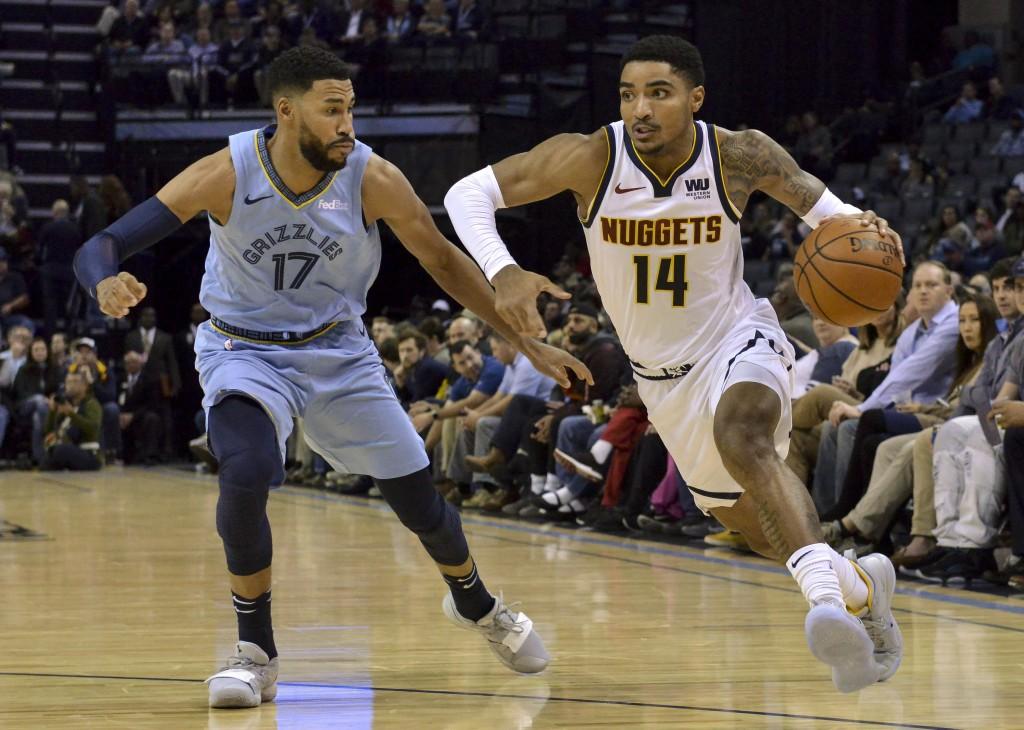 Denver Nuggets guard Gary Harris (14) drives against Memphis Grizzlies guard Garrett Temple (17) in the first half of an NBA basketball game Wednesday