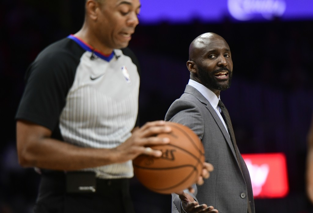 Atlanta Hawks coach Lloyd Pierce has words for referee Carl Lane, left, during the first half of the team's NBA basketball game against the New York K