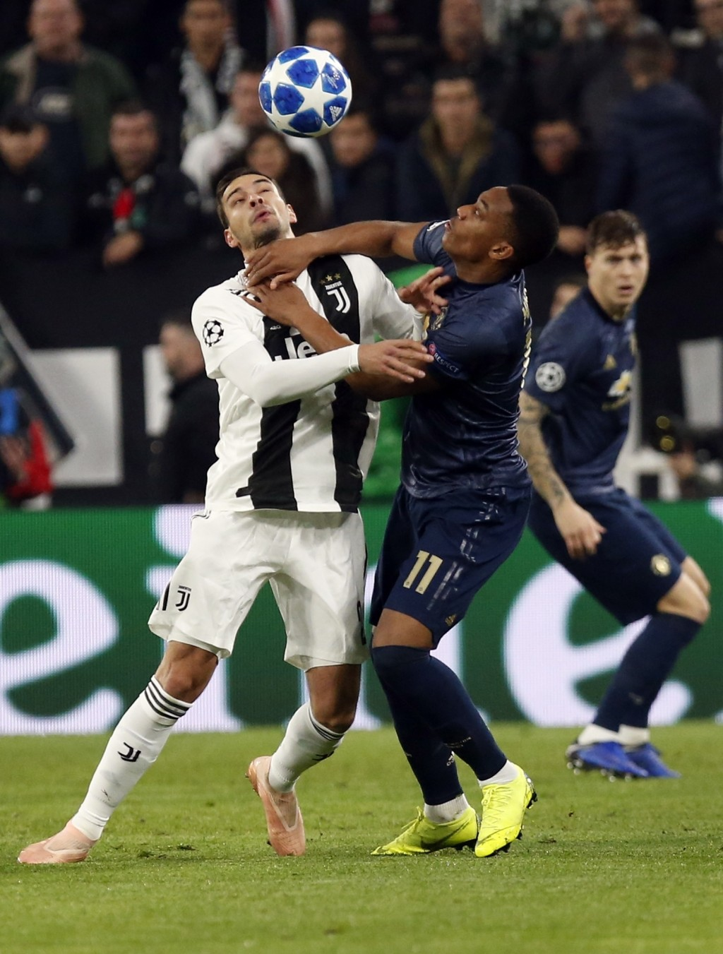 Juventus defender Mattia De Sciglio and ManU forward Anthony Martial, right, vie for the ball during the Champions League group H soccer match between