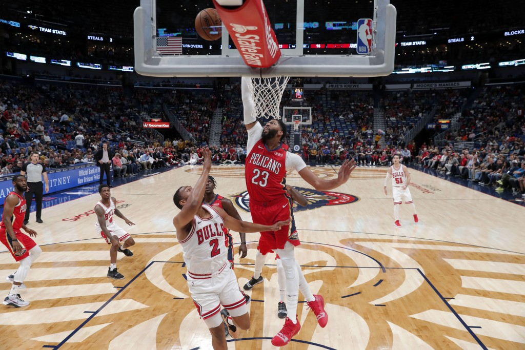 New Orleans Pelicans forward Anthony Davis (23) tries to block a shot by Chicago Bulls forward Jabari Parker (2) during the first half of an NBA baske...