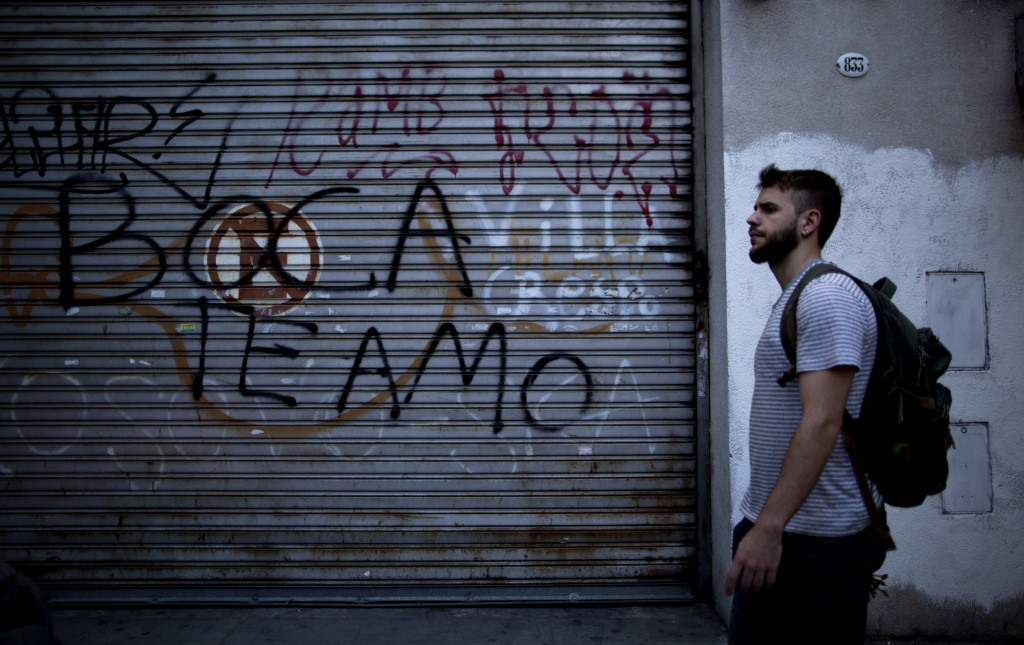 "A man walks by a graffiti reading "" Boca Juniors I love you"" in Buenos Aires, Argentina Wednesday, Nov. 7, 2018. Boca Juniors will face Play River Pla"
