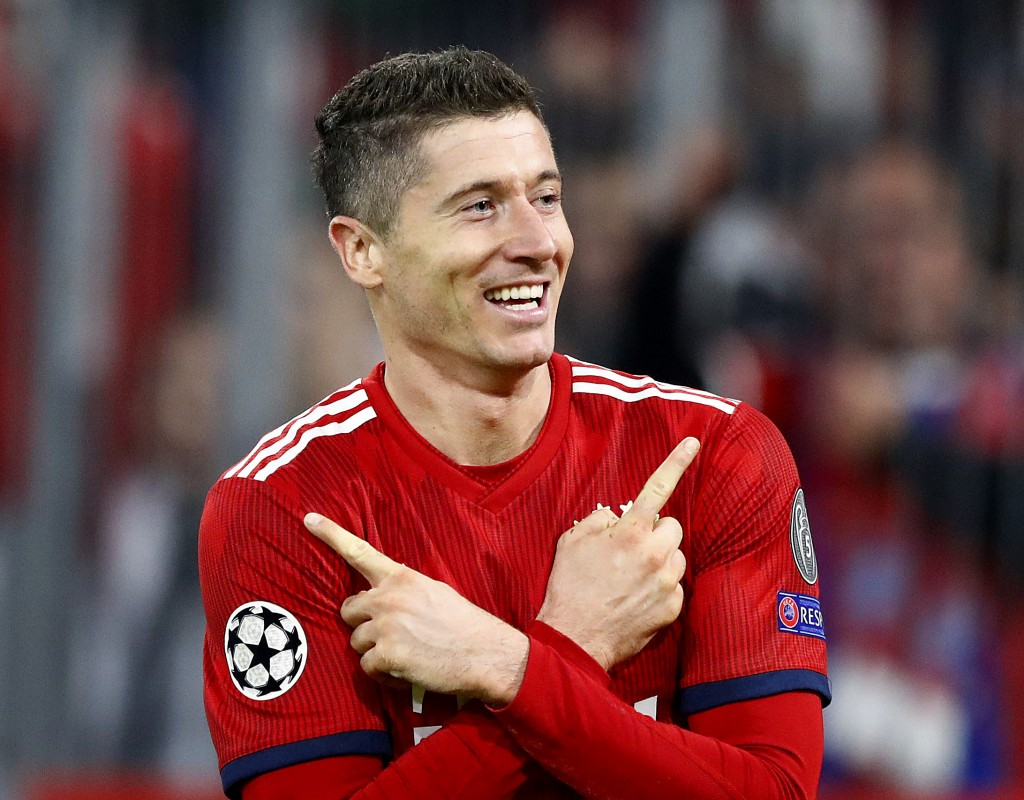 Bayern forward Robert Lewandowski celebrates his side's second goal during the Champions League group E soccer match between FC Bayern Munich and AEK