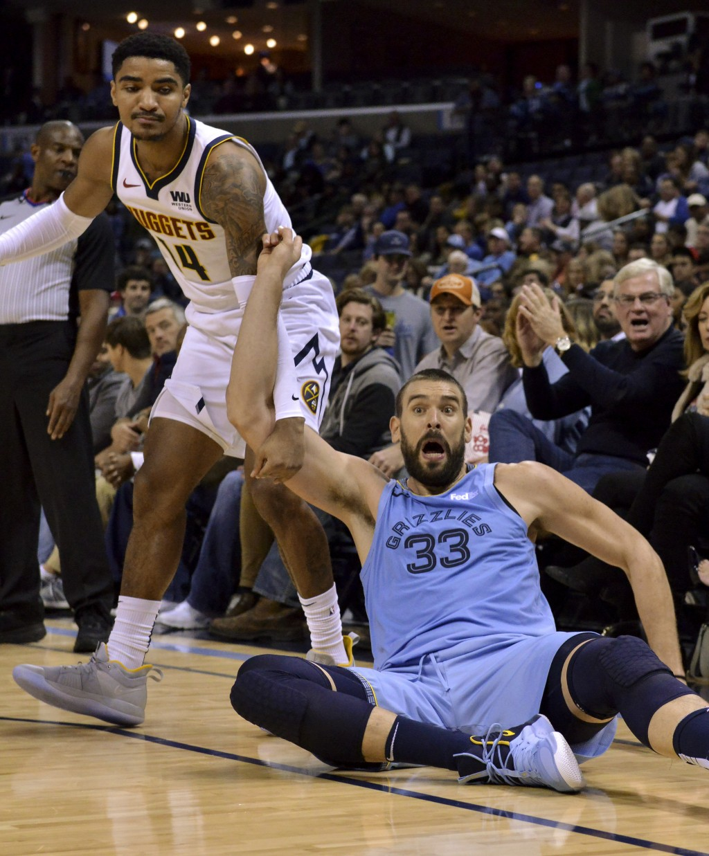 Memphis Grizzlies center Marc Gasol (33) and Denver Nuggets guard Gary Harris (14) react after losing control of the ball in the first half of an NBA ...