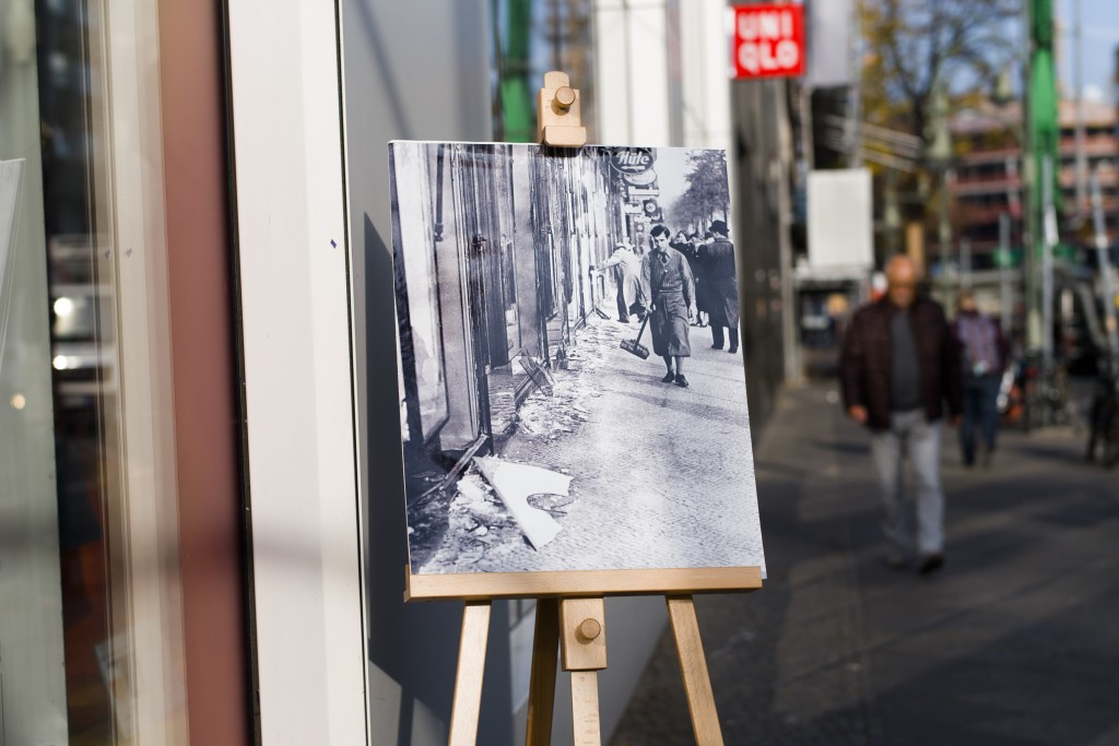 In this Wednesday, Nov. 7, 2018 photo a Nov. 10, 1938 photo from the AP Archive, showing by Nazis destroyed Jewish shops at the Nuernberger Strasse st