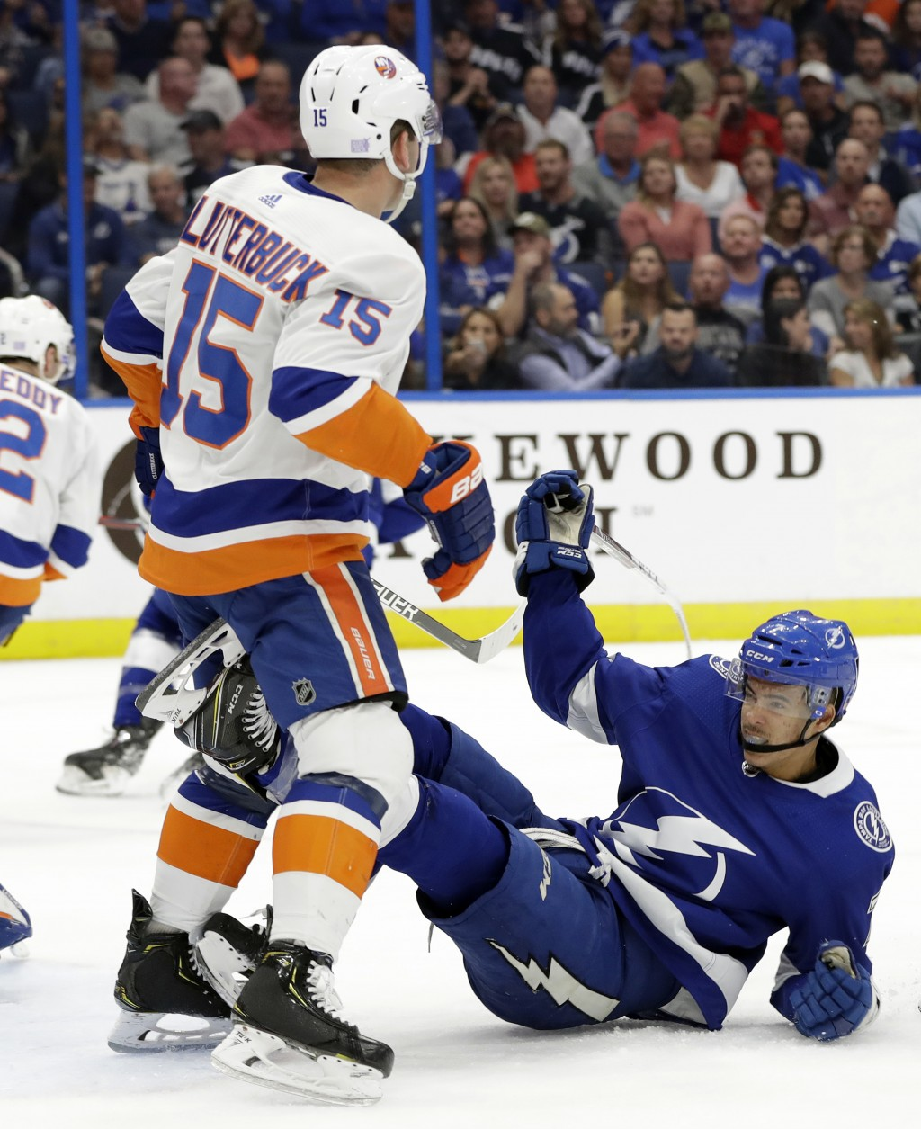 New York Islanders right wing Cal Clutterbuck (15) knocks down Tampa Bay Lightning right wing Mathieu Joseph during the second period of an NHL hockey