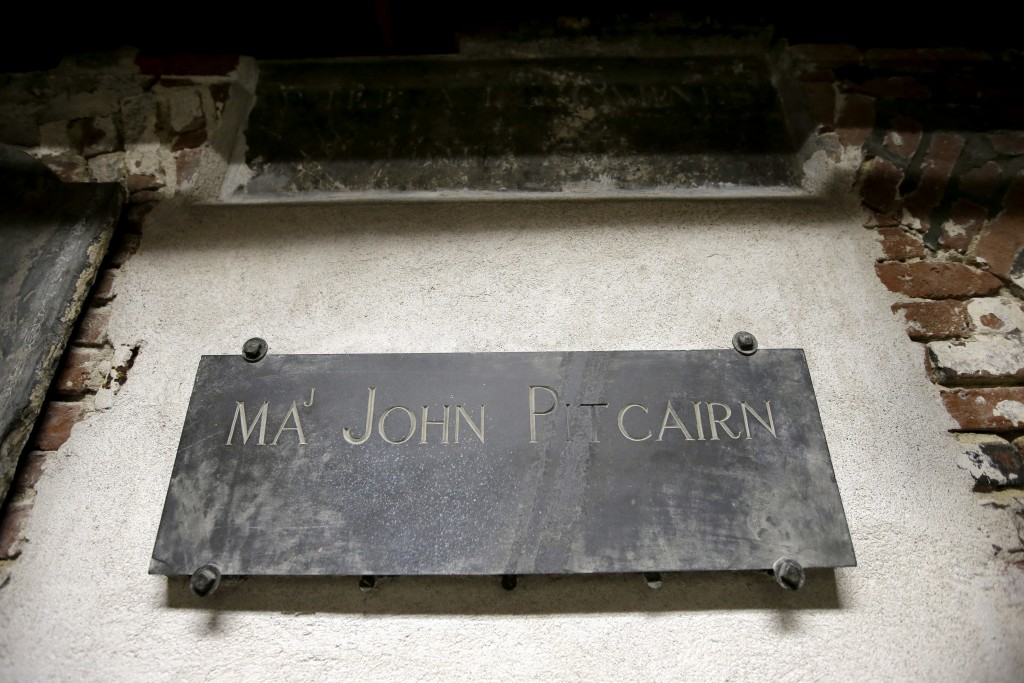 In this Wednesday, Nov. 7, 2018 photo, a plaque marks the tomb of Revolutionary War British Marine Major John Pitcairn in the basement of Old North Ch