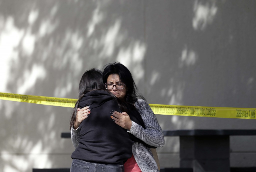 Mourners embrace outside of the Thousand Oaks Teen Center on Thursday, Nov. 8, 2018, where relatives and friends gathered in the aftermath of the Wedn...