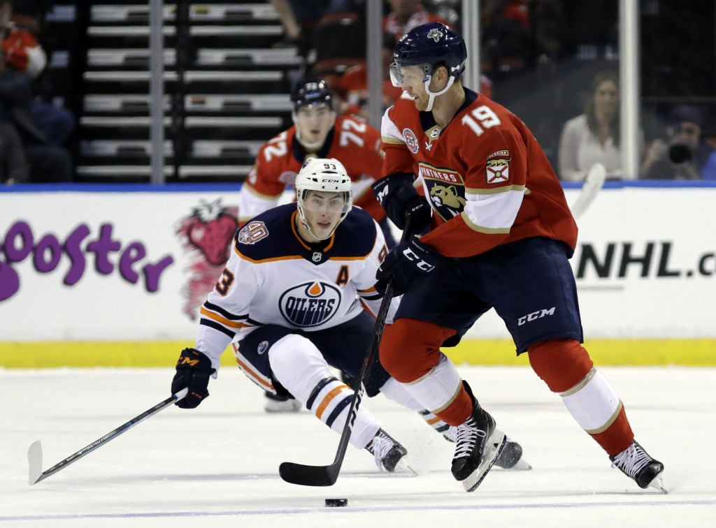 Florida Panthers defenseman Mike Matheson (19) skates with the puck as Edmonton Oilers center Ryan Nugent-Hopkins (93) defends during the second perio