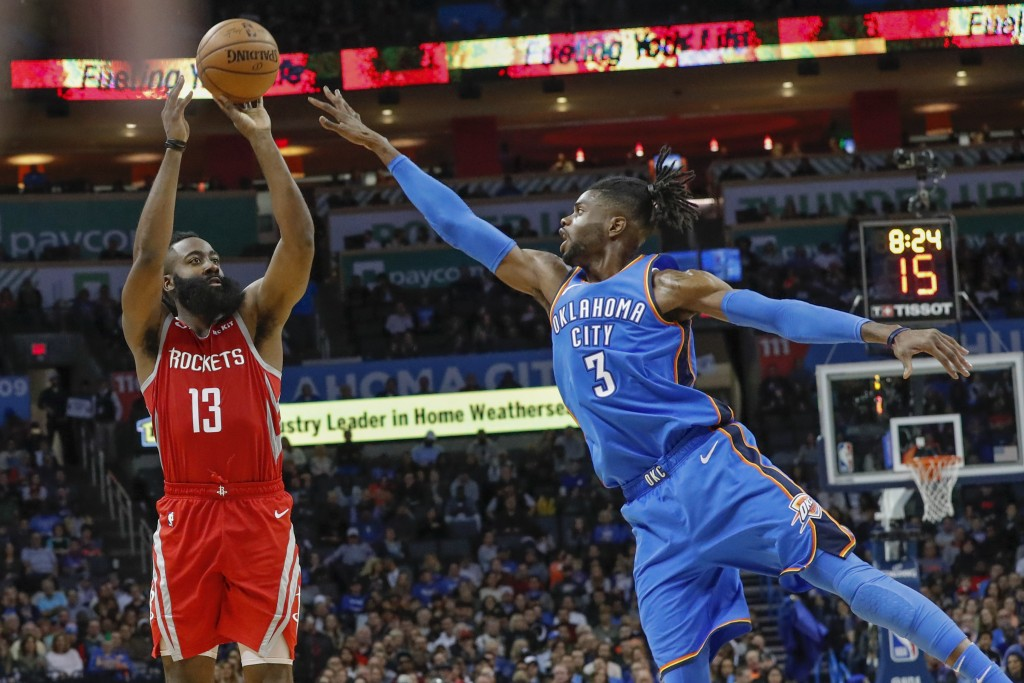 Houston Rockets guard James Harden (13) shoots as Oklahoma City Thunder forward Nerlens Noel (3) defends during the second half of an NBA basketball g
