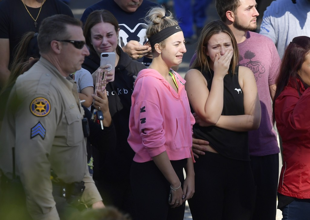 People cry as a law enforcement motorcade escorts the body of Ventura County Sheriff's Department Sgt. Ron Helus from the Los Robles Regional Medical