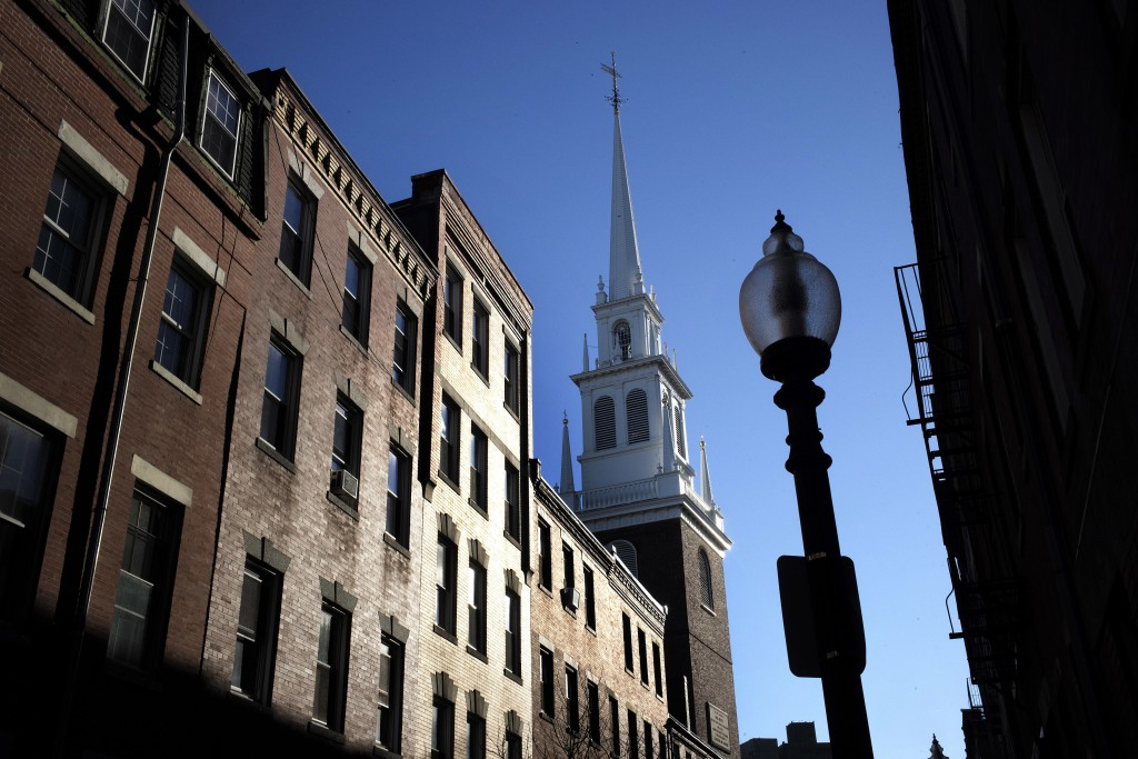 In this Wednesday, Nov. 7, 2018 photo Old North Church stands among buildings in the North End neighborhood of Boston. A memorial honoring fallen sold