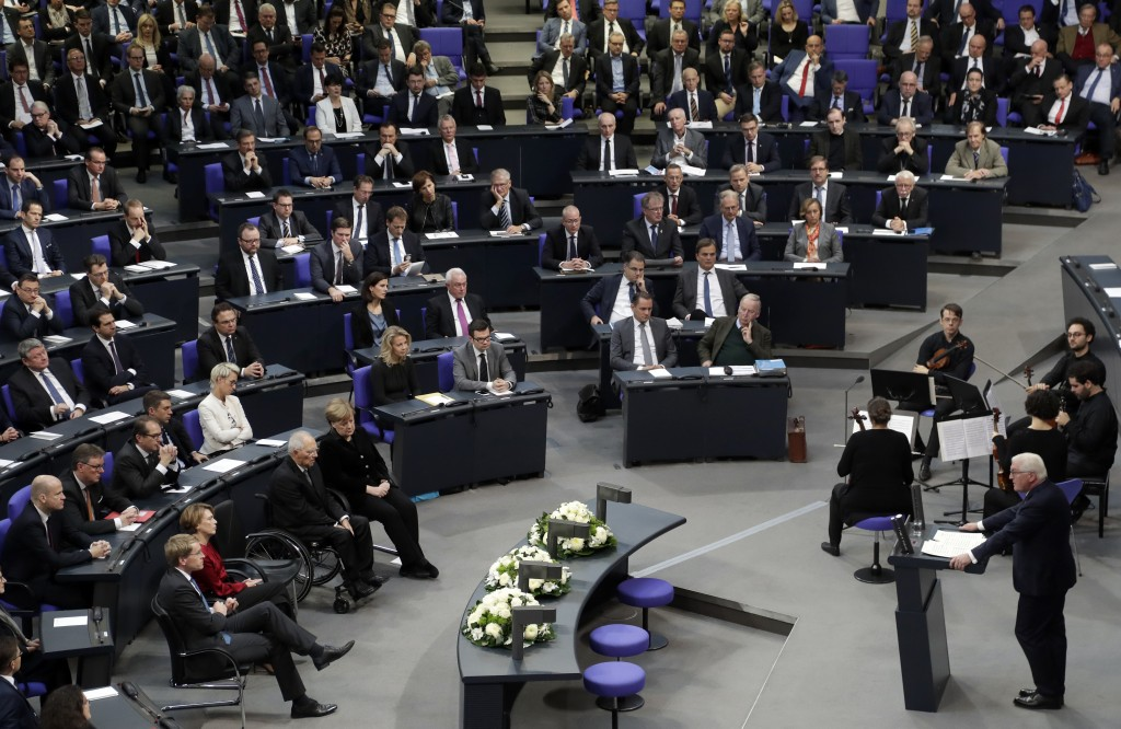 German President Frank-Walter Steinmeier, front right, delivers a speech during an hour of commemoration in the German federal parliament, Bundestag,