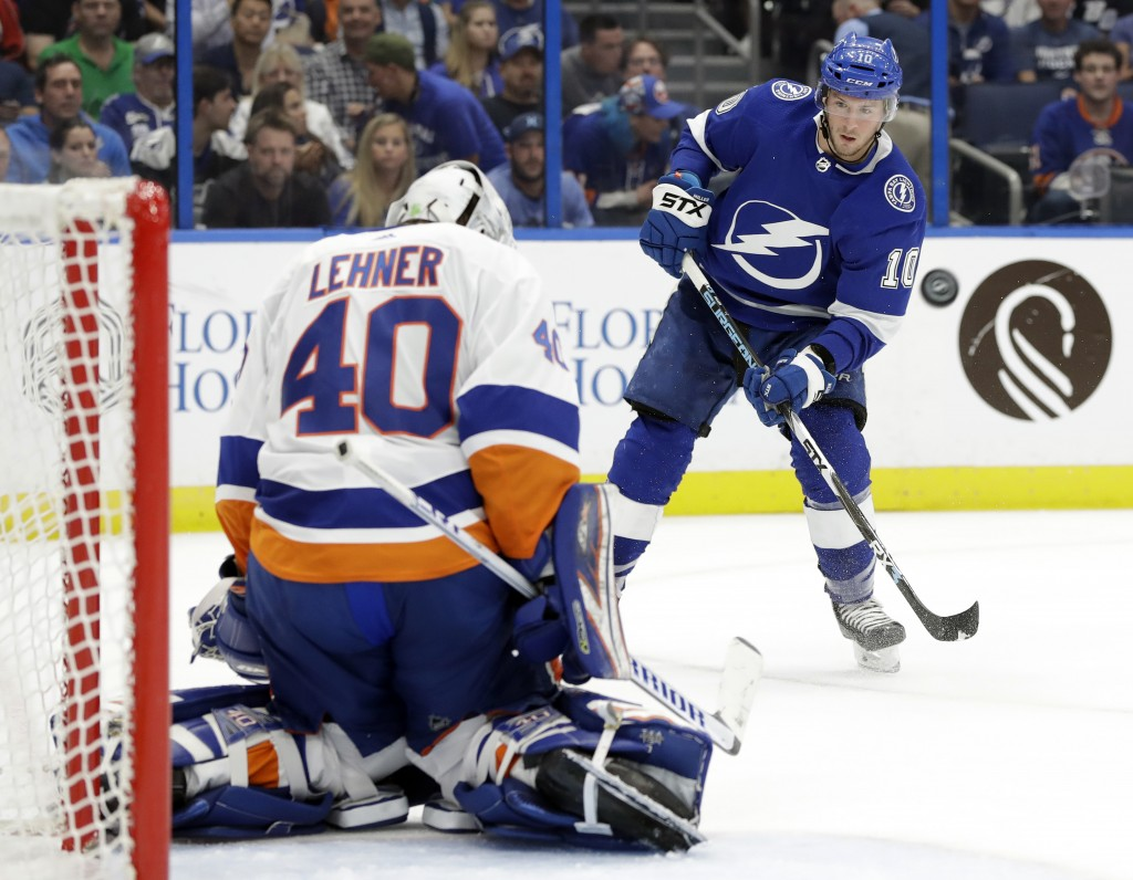 Tampa Bay Lightning center J.T. Miller (10) watches as New York Islanders goaltender Robin Lehner (40) stops his shot during the second period of an N
