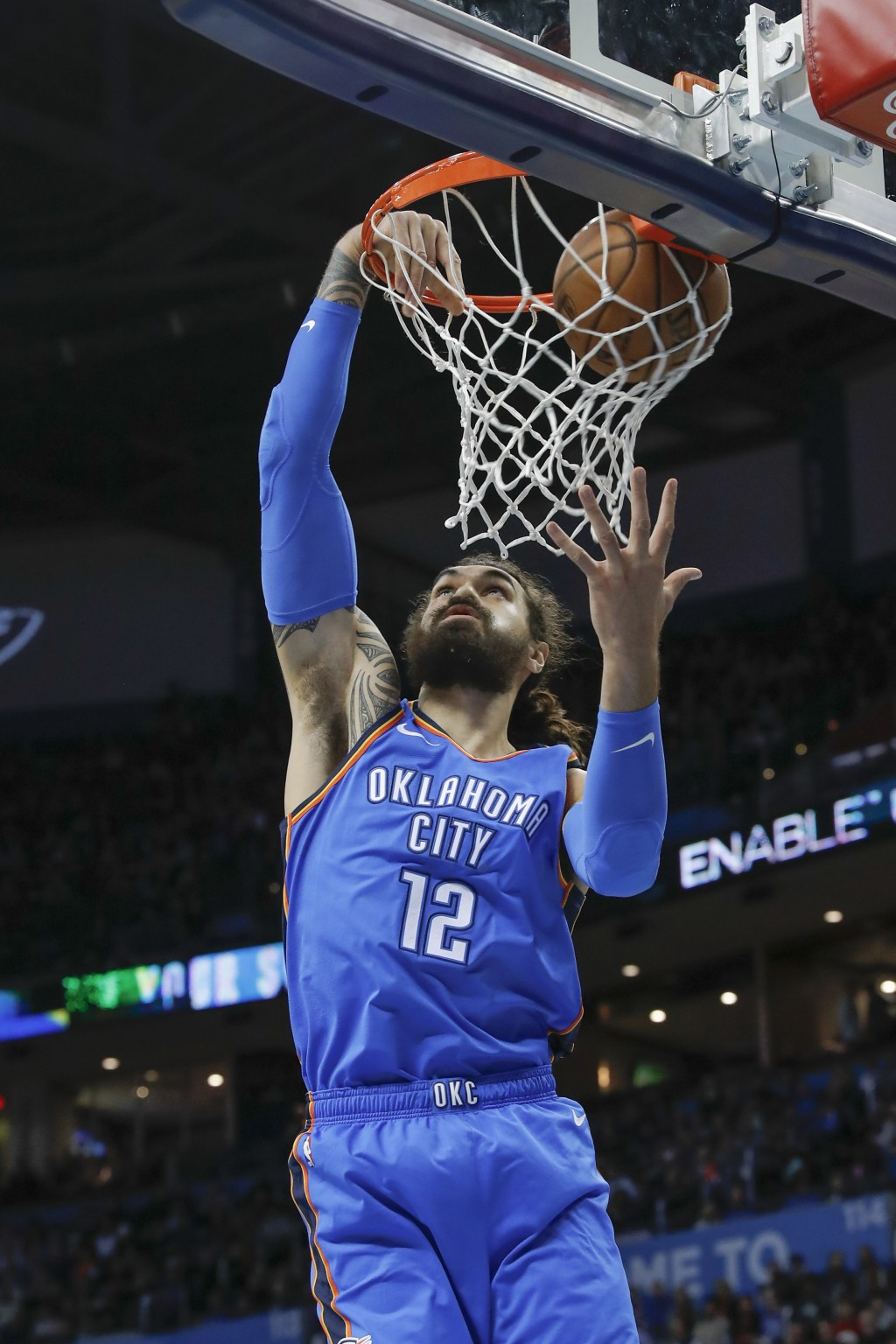 Oklahoma City Thunder center Steven Adams (12) goes up for a basket against the Houston Rockets during the first quarter of an NBA basketball game Thu