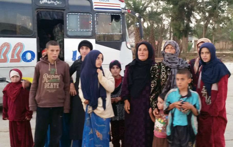 In this photo released by the Syrian official news agency SANA, shows women and children who has been liberated from the Islamic State group in the Ha