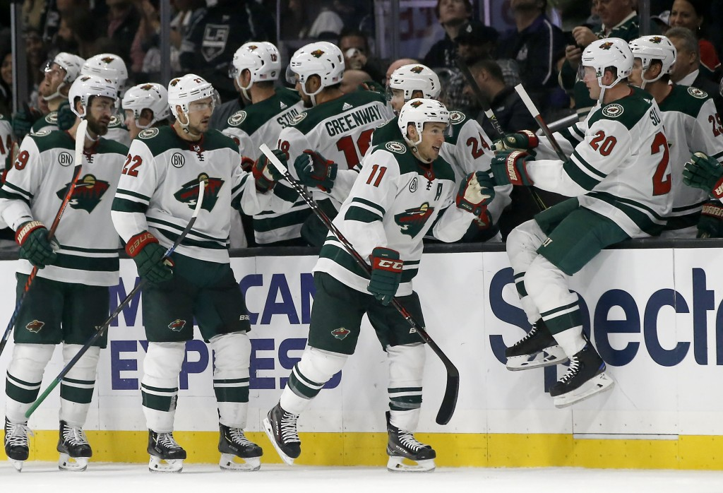 Minnesota Wild left wing Zach Parise (11) is congratulated by teammates, including defenseman Ryan Suter (20), after his goal during the second period