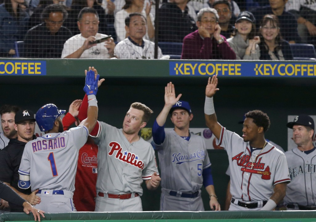 MLB All-Star shortstop Amed Rosario (1) of the New York Mets celebrates with teammates at the bench after hitting a solo home-run off All Japan's star