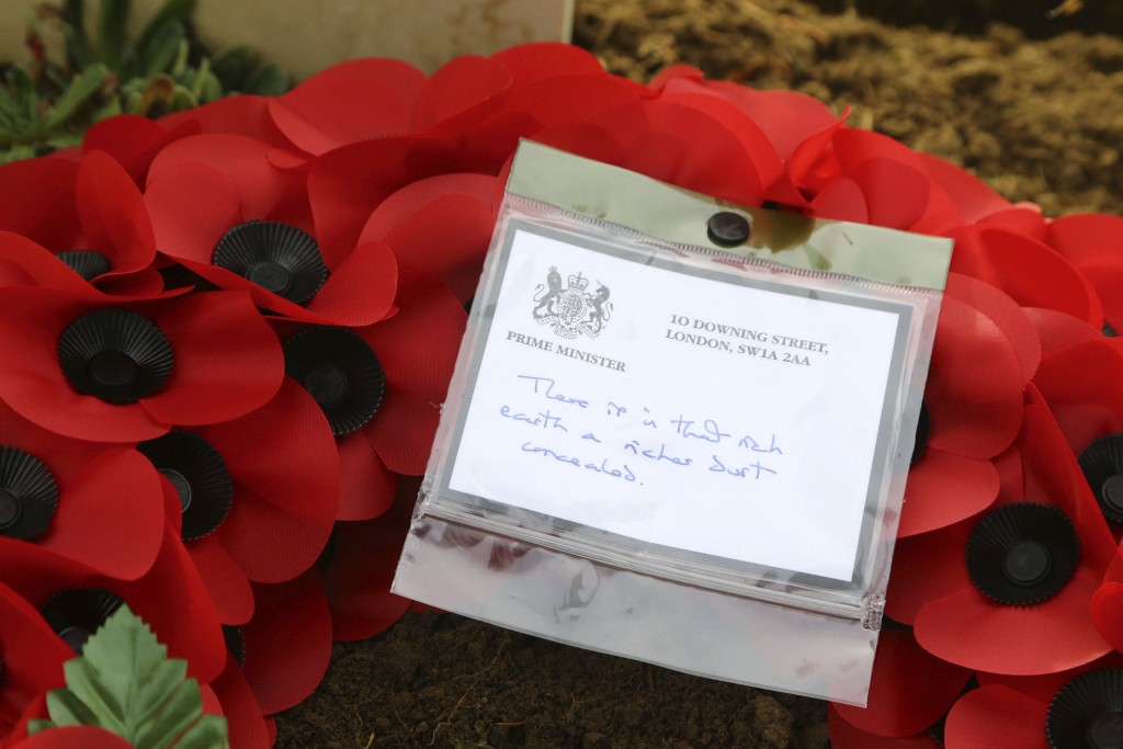 The wreath of Britain's Prime Minister Theresa May at the grave of John Parr, the first British soldier to be killed in WWI in 1914, at the St Symphor...