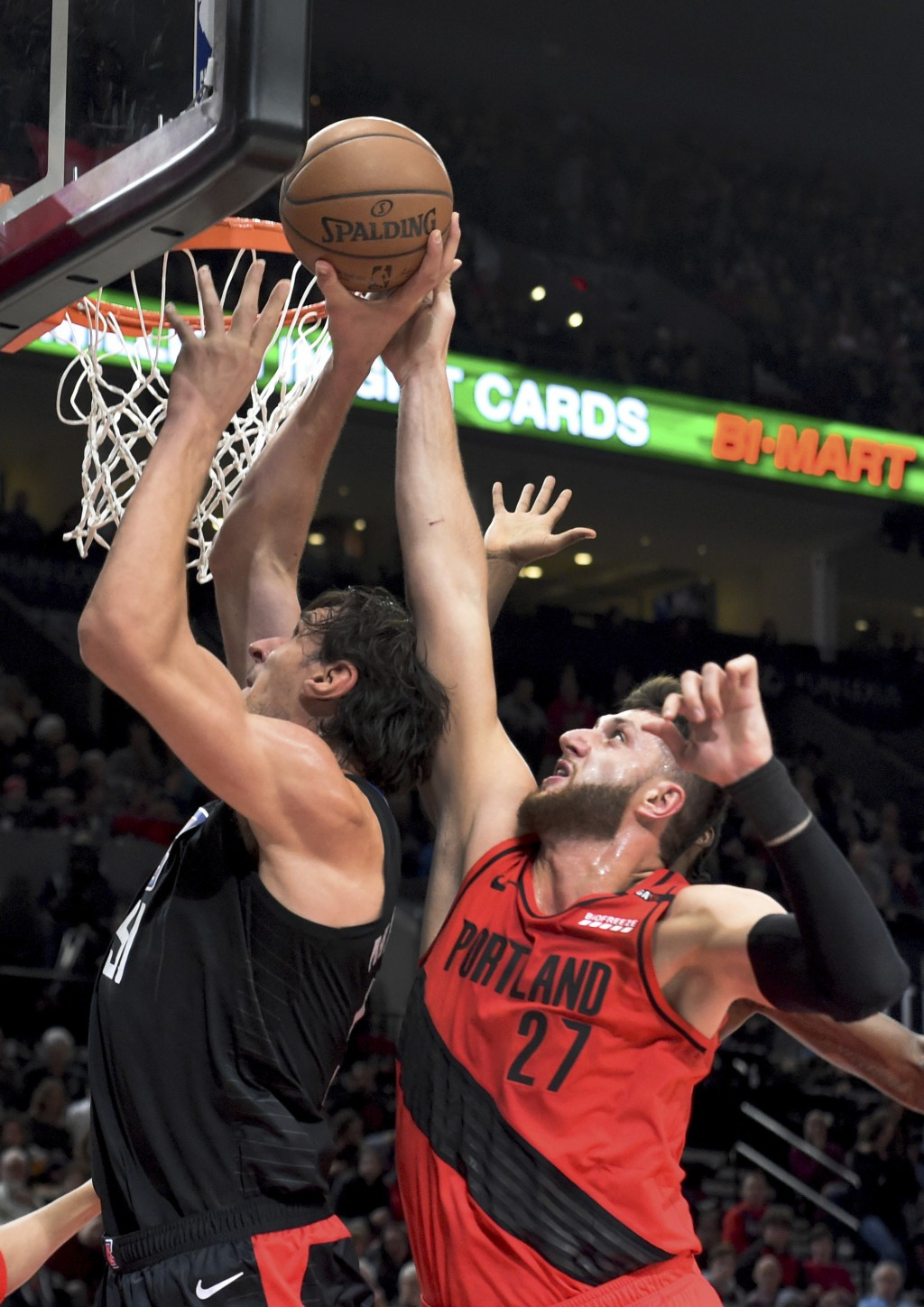 Portland Trail Blazers center Jusuf Nurkic, right, blocks the shot of Los Angeles Clippers center Boban Marjanovic, left, during the first half of an