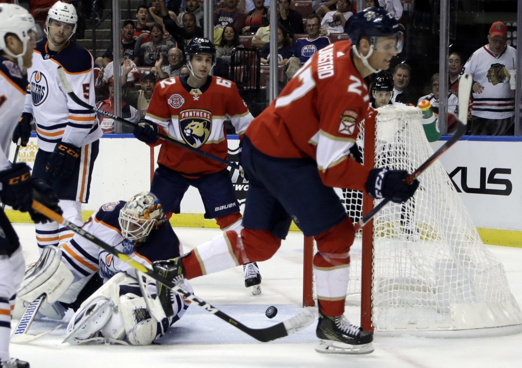 The puck gets past Edmonton Oilers goaltender Cam Talbot, left, on a goal scored by Florida Panthers center Nick Bjugstad (27) during the second perio