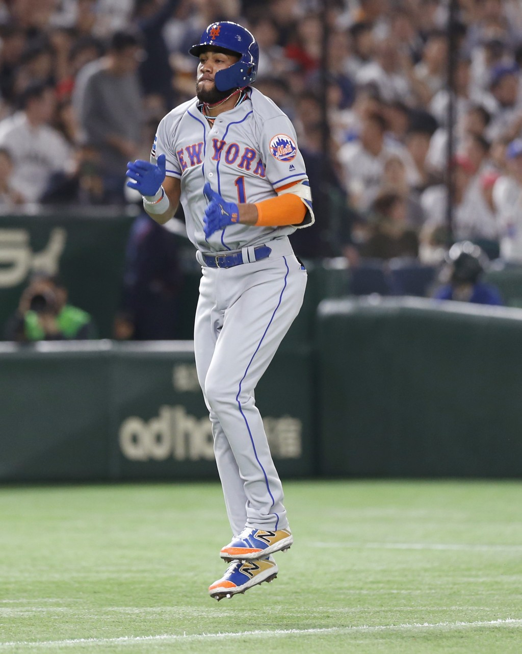 MLB All-Star shortstop Amed Rosario (1) of the New York Mets celebrates while rounding bases after hitting a solo home-run off All Japan's starting pi