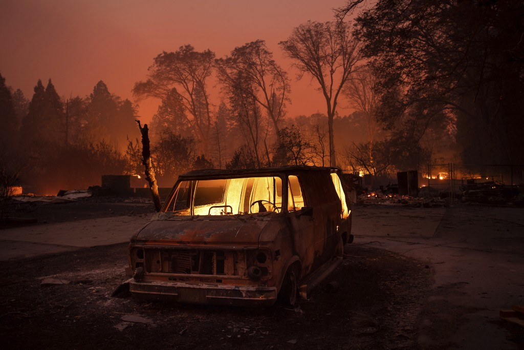 Flames burn inside a van as the Camp Fire tears through Paradise, Calif., on Thursday, Nov. 8, 2018. Tens of thousands of people fled a fast-moving wi