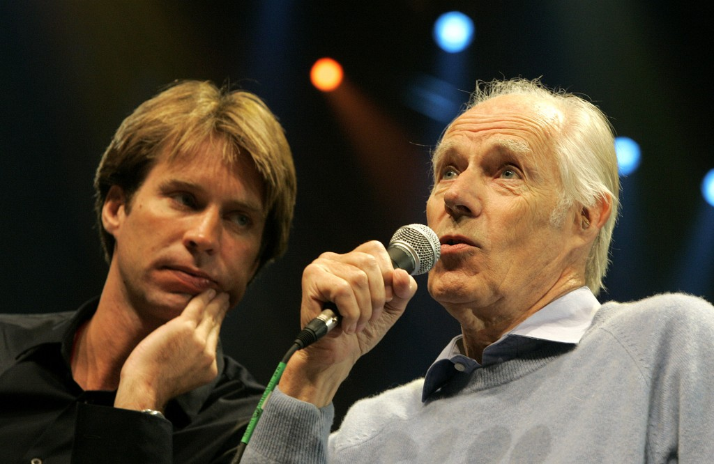 FILE - In this May 24, 2006 file photo, Giles Martin, left, listens as his father, original Beatles producer George Martin speaks after a sneak previe