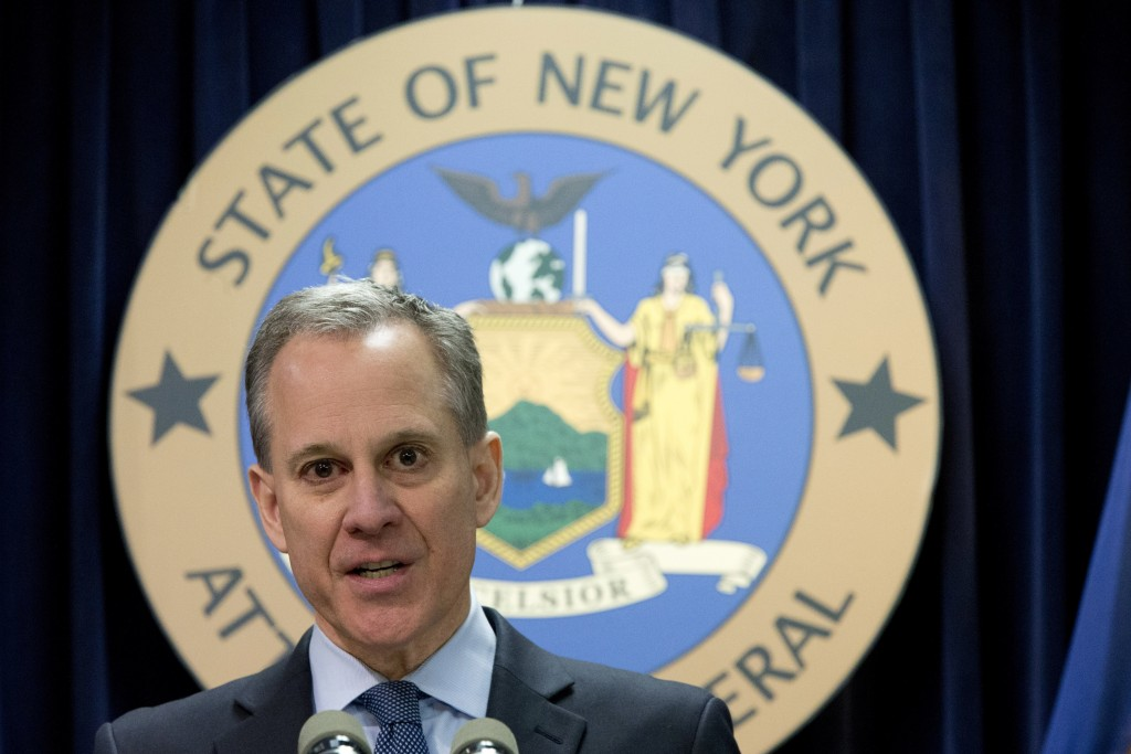 FILE - In this Feb. 11, 2016, file photo, New York Attorney General Eric T. Schneiderman speaks during a news conference in New York. The prosecutor a