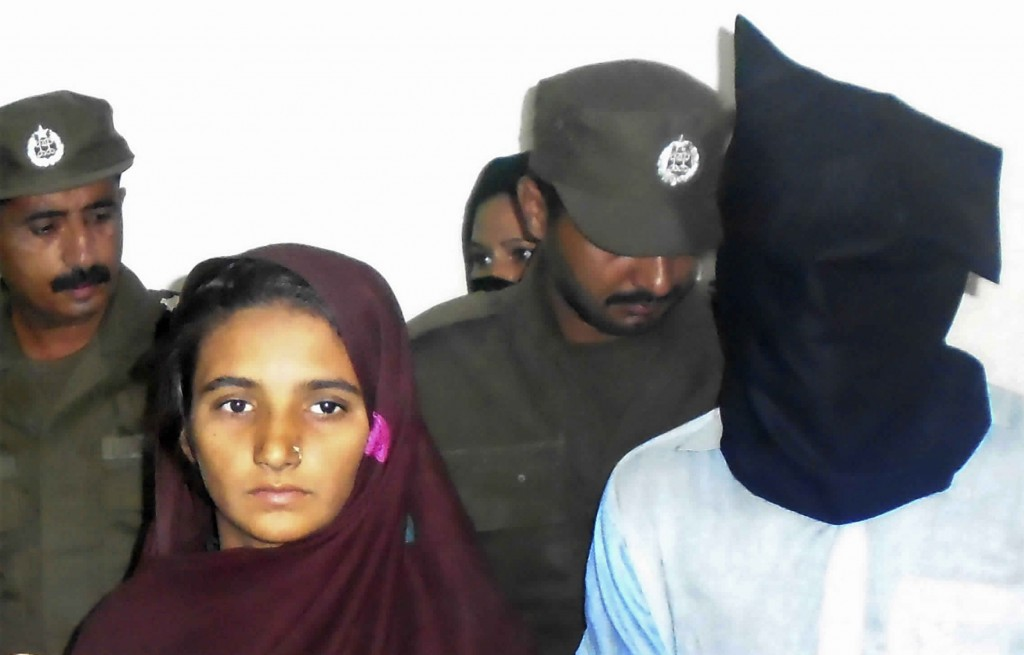 FILE - In this Monday, Oct. 30, 2017 file photo, Aasia Bibi and her boyfriend, Shahid Lashari, are presented to journalists, at police station in Muza