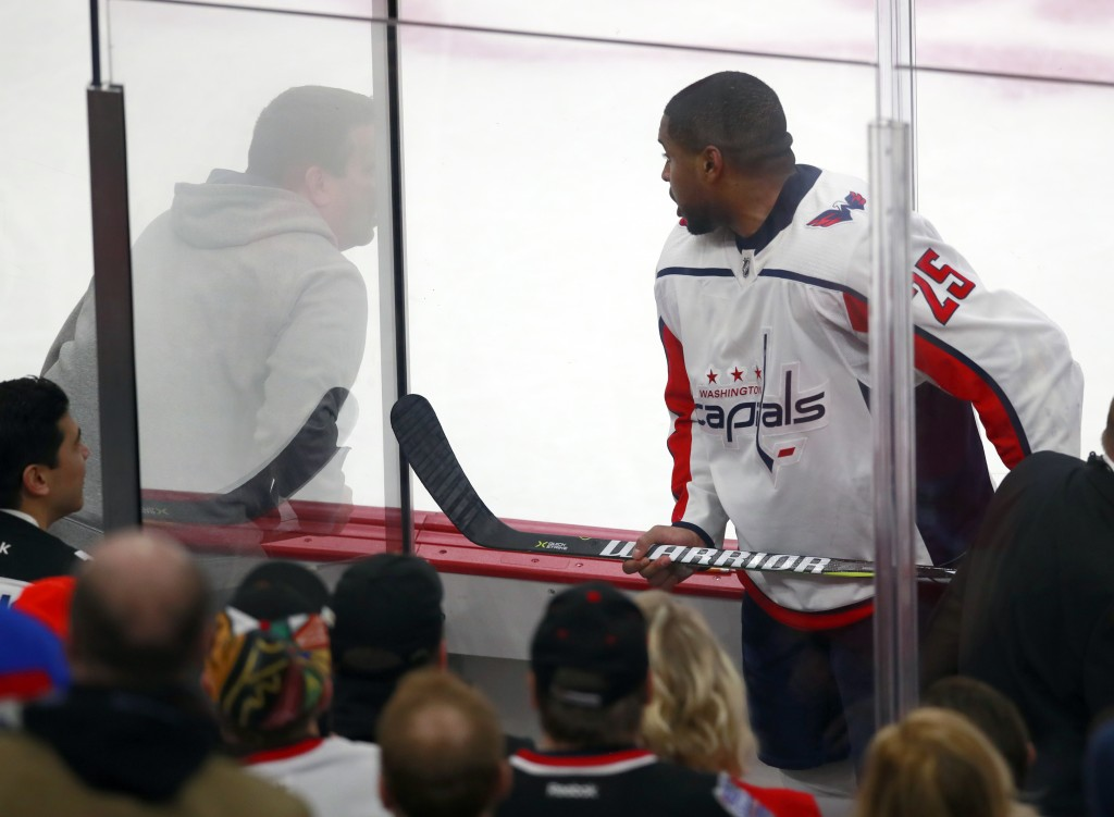 FILE - In this Feb. 17, 2018, file photo, Washington Capitals right wing Devante Smith-Pelly (25) argues from the penalty box with Chicago Blackhawks