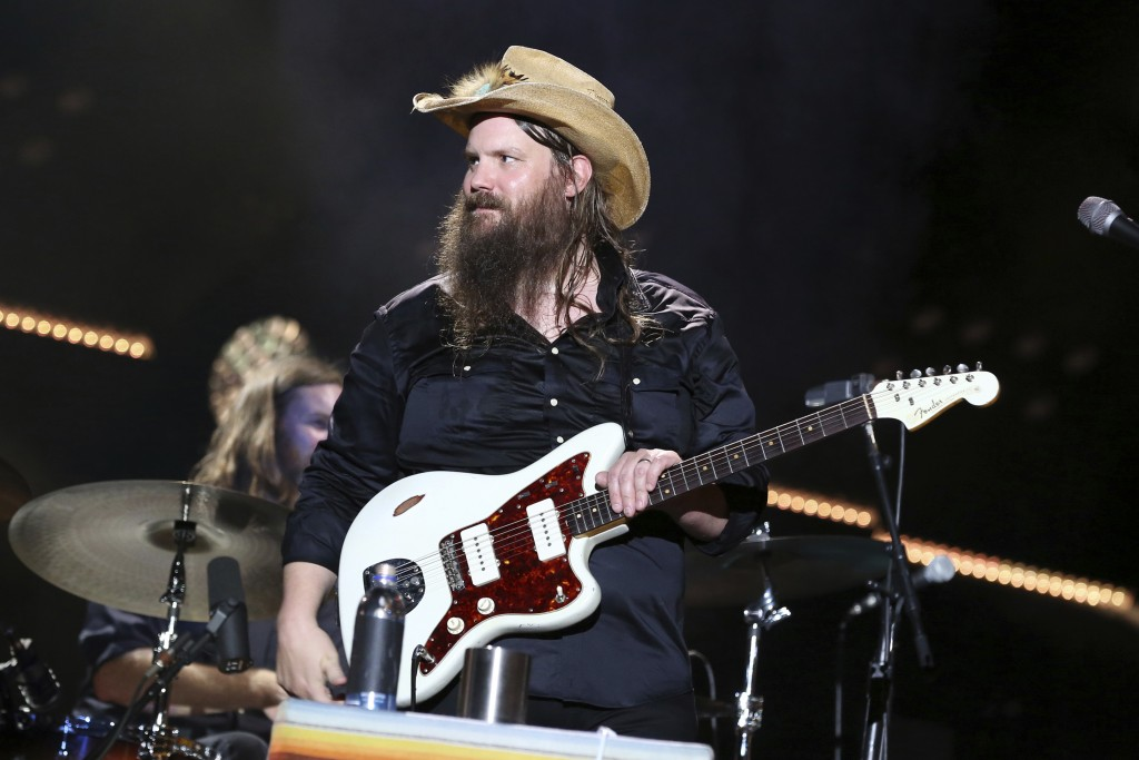 "FILE - In this June 9, 2018 file photo, Chris Stapleton performs at the 2018 CMA Music Festival in Nashville, Tenn. Stapleton's ""Broken Halos"" is nomi"
