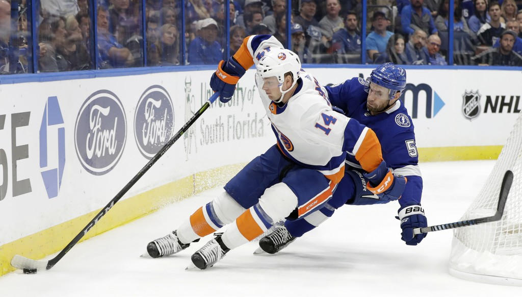 New York Islanders right wing Tom Kuhnhackl (14) gets around Tampa Bay Lightning defenseman Dan Girardi (5) during the first period of an NHL hockey g