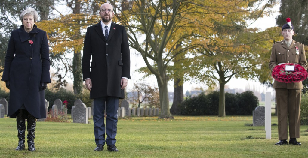 British Prime Minister Theresa May, left, and Belgian Prime Minister Charles Michel, center, prepare to lay wreaths at the graves of British World War