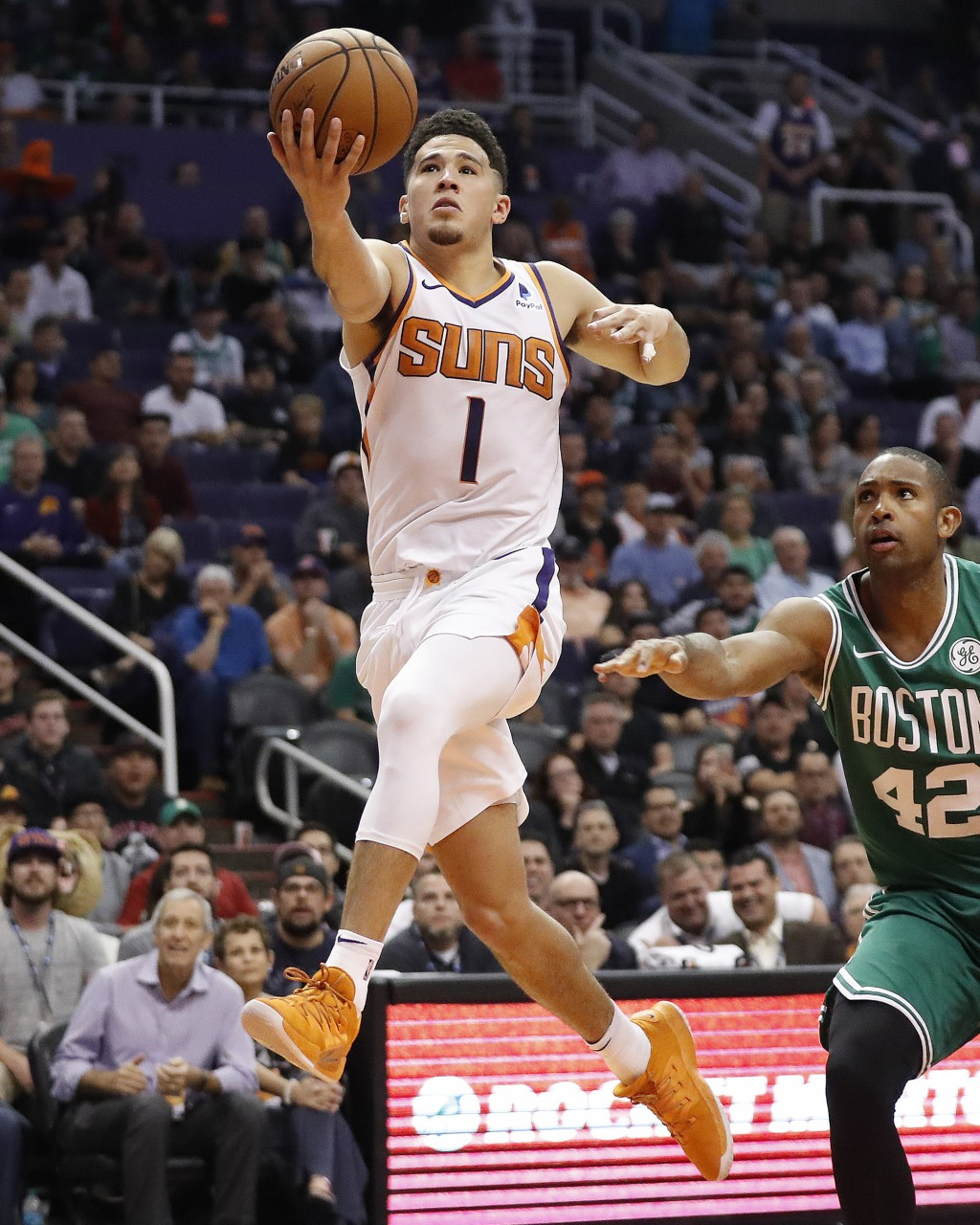 Phoenix Suns guard Devin Booker (1) shoots against the Boston Celtics during the second half of an NBA basketball game Thursday, Nov. 8, 2018, in Phoe
