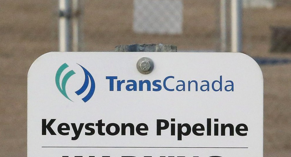 FILE- This Nov. 6, 2015, file photo shows a sign for TransCanada's Keystone pipeline facilities in Hardisty, Alberta,  A federal judge in Montana has