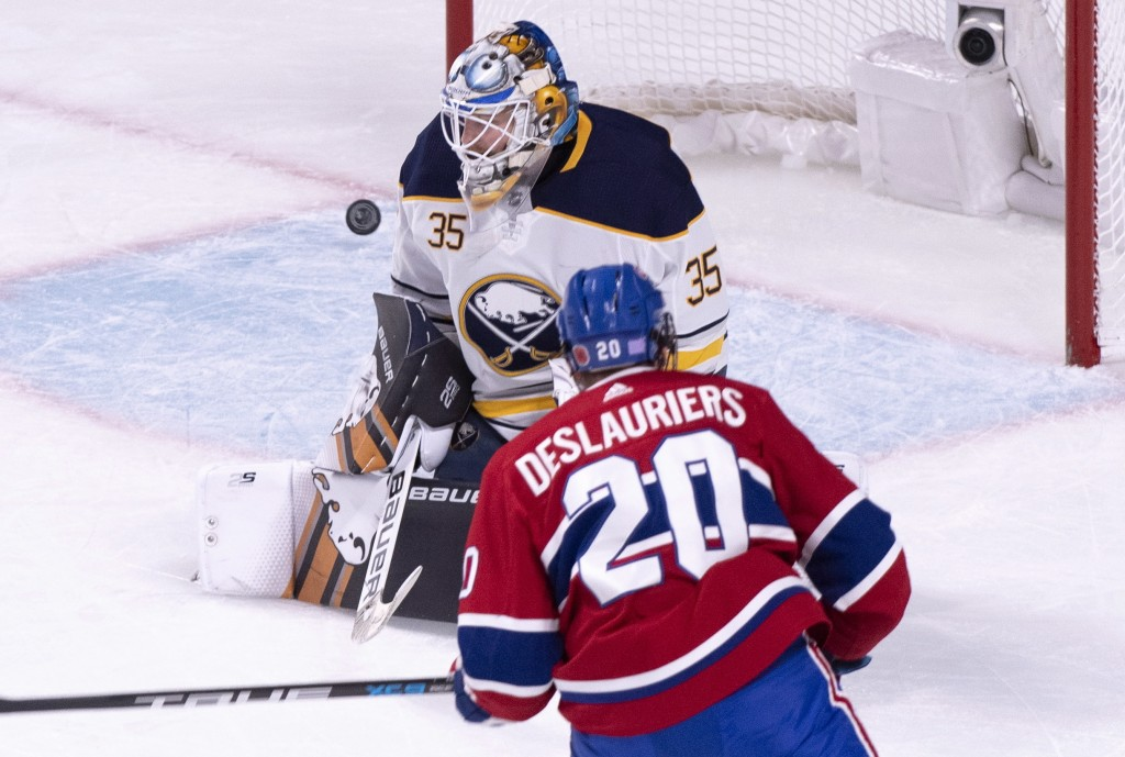 Montreal Canadiens' Nicolas Deslauriers scores a short-handed goal past Buffalo Sabres goaltender Linus Ullmark during the second period of an NHL hoc