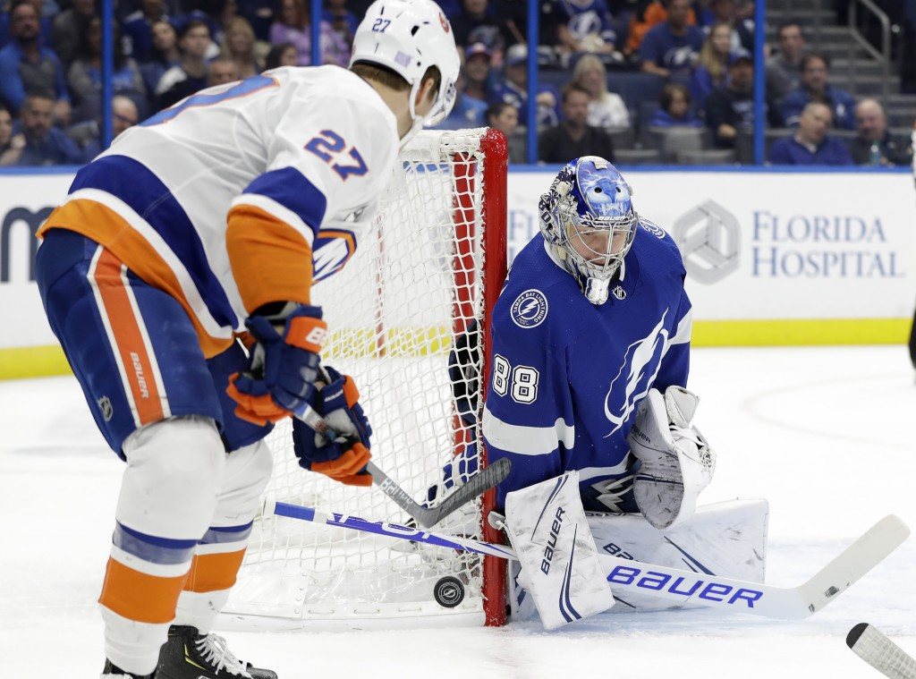 Tampa Bay Lightning goaltender Andrei Vasilevskiy (88) makes a save on a shot by New York Islanders left wing Anders Lee (27) during the first period