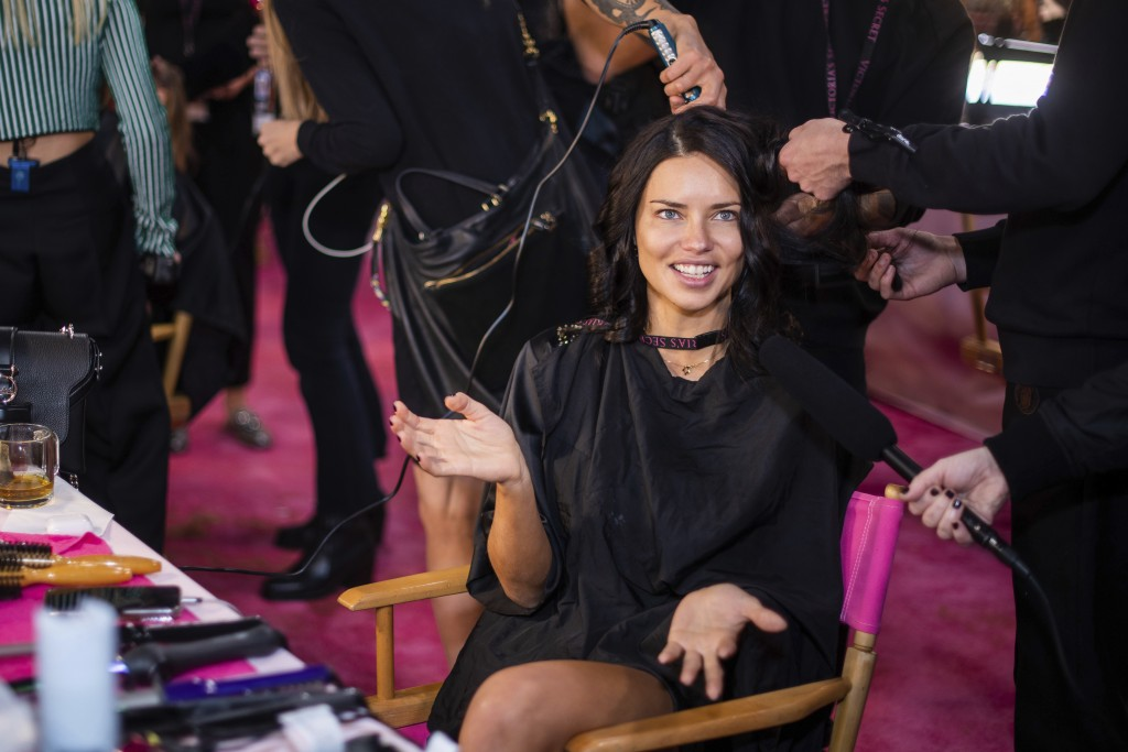 Adriana Lima appears backstage during hair and makeup at the 2018 Victoria's Secret Fashion Show at Pier 94 on Thursday, Nov. 8, 2018, in New York. (P