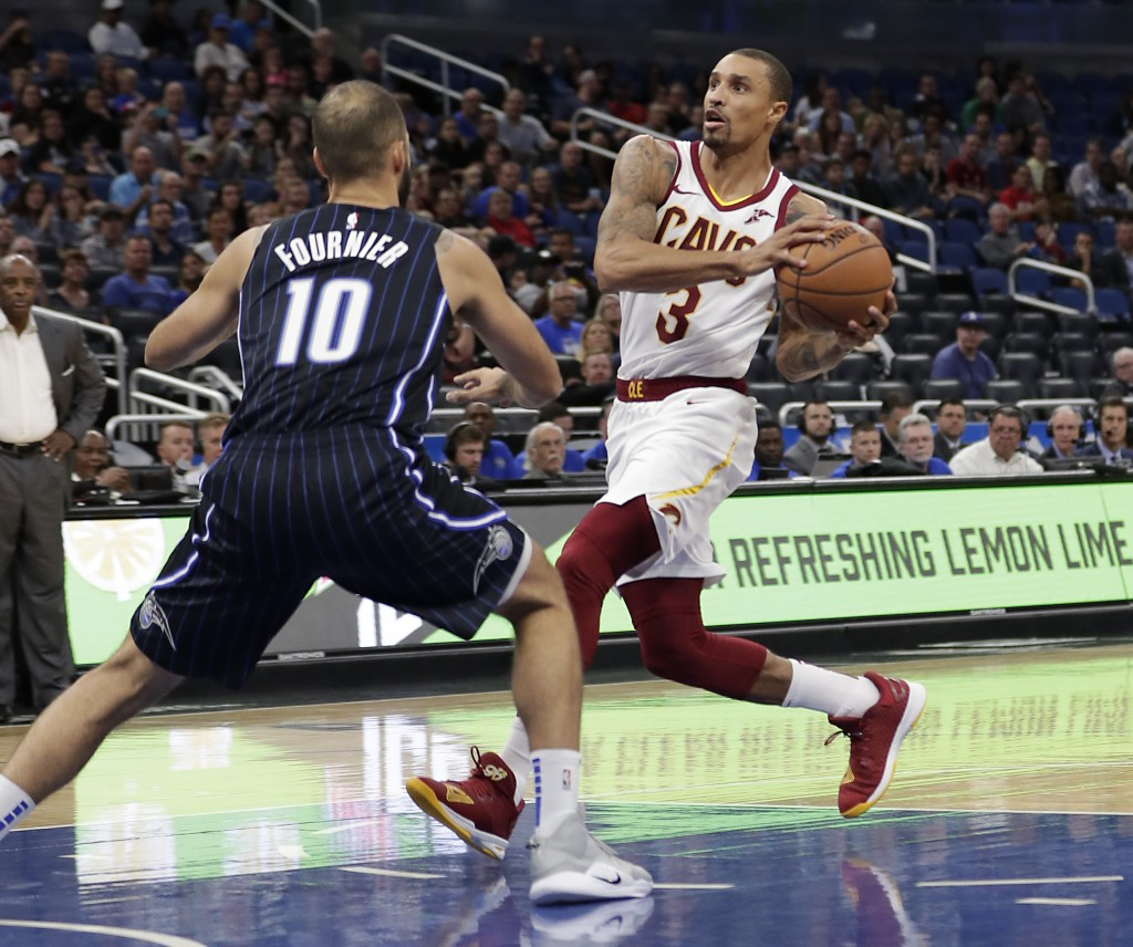 FILE - In this Nov. 5, 2018, file photo, Cleveland Cavaliers' George Hill (3) drives to the basket against Orlando Magic's Evan Fournier (10) during t