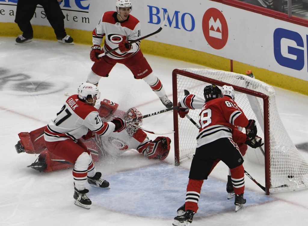 Chicago Blackhawks right wing Patrick Kane (88) scores a goal on Carolina Hurricanes goaltender Scott Darling, second left, during the second period o