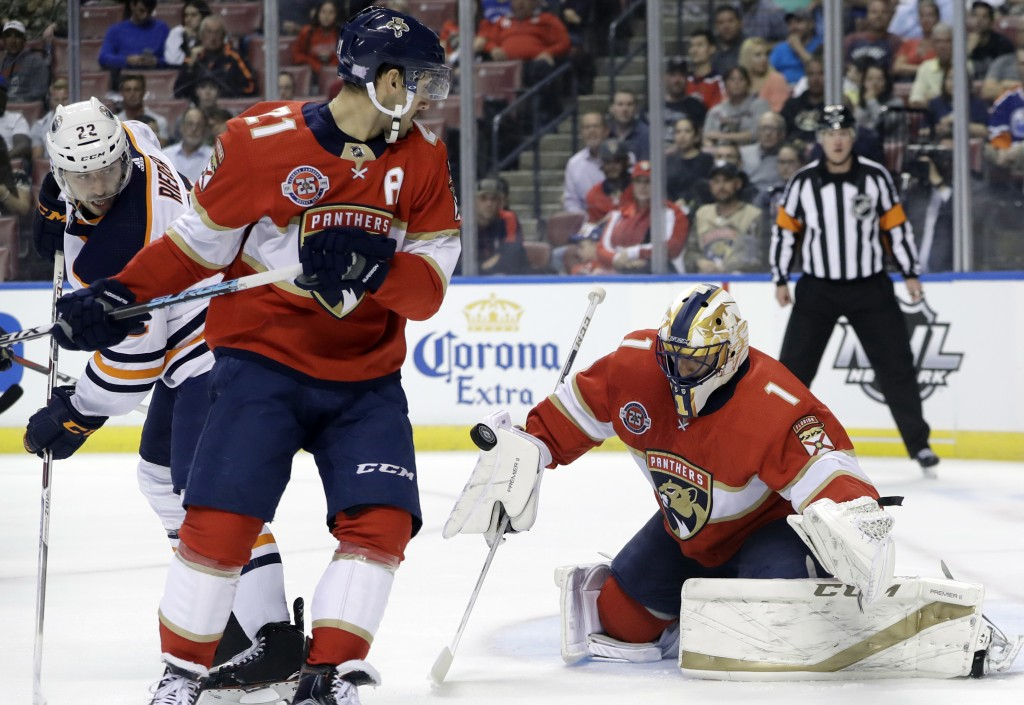 Florida Panthers goaltender Roberto Luongo (1) stops the puck as Edmonton Oilers right wing Tobias Rieder (22) and Florida Panthers center Vincent Tro