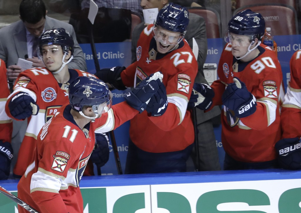 Florida Panthers left wing Jonathan Huberdeau (11) is congratulated by Nick Bjugstad (27) and Jared McCann (90) after scoring a goal during the third