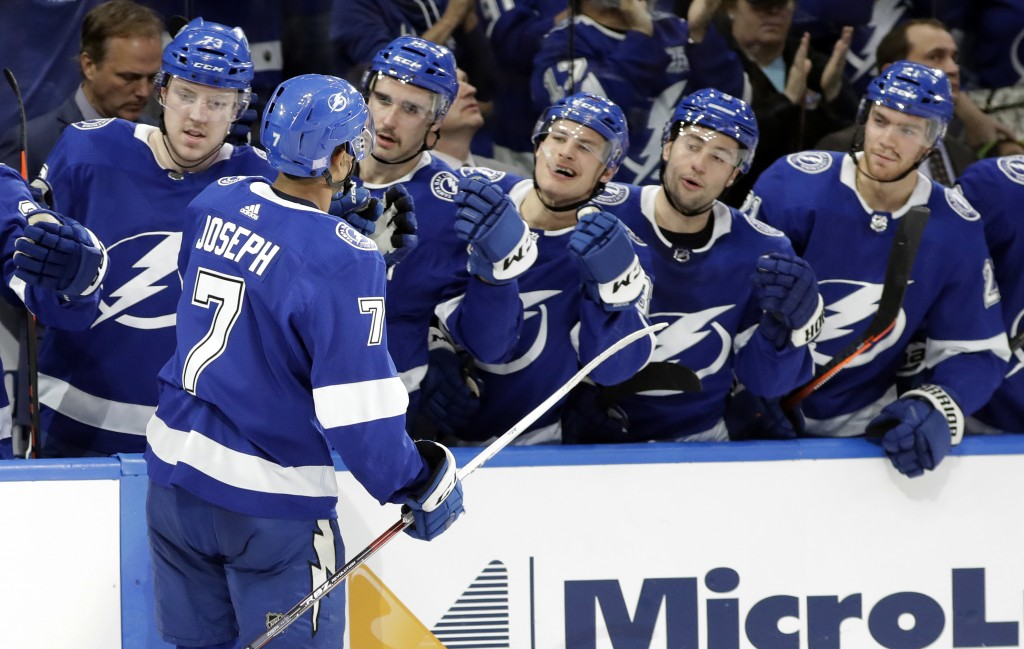 Tampa Bay Lightning right wing Mathieu Joseph (7) celebrates with teammates on the bench after his goal against the New York Islanders during the seco